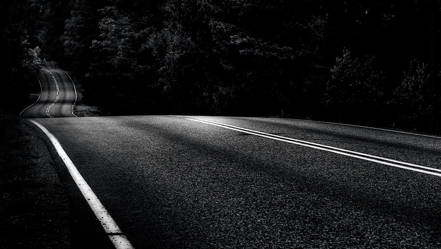 The road is long, winding, and spooky in the early morning hours,